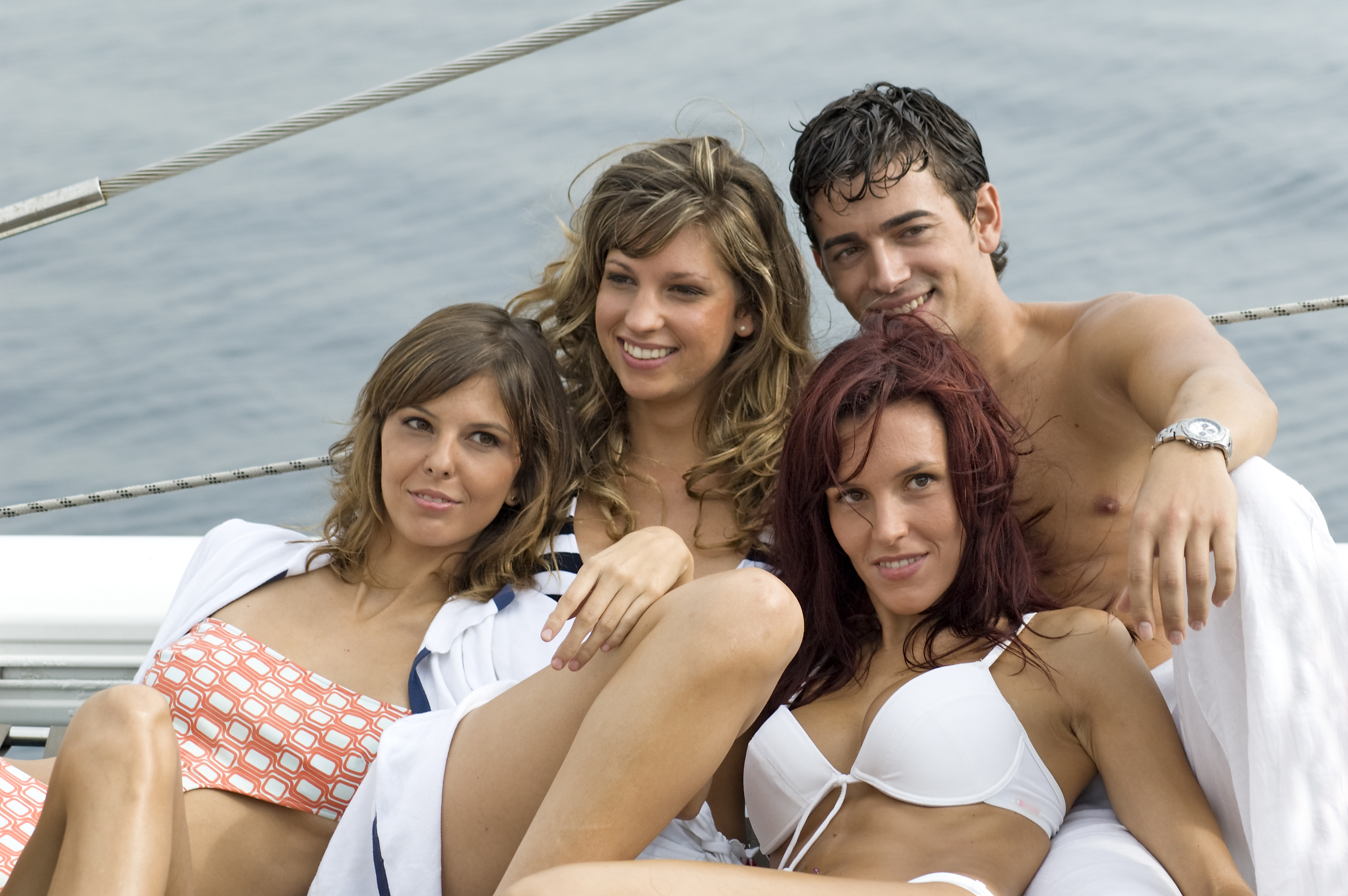 Online Dating: Why Do Men Post Photos With Hot, Half-Naked Girls All Over Them?